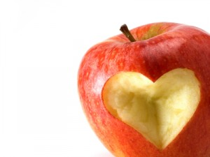 red apple with a carved heart