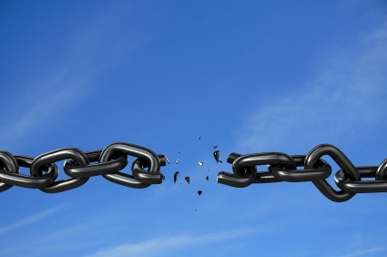 chain breaking against blue sky